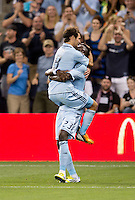 Graham Zusi (8) of Sporting Kansas City celebrates his goal with teammate Kei Kamara (23) during the game at Livestrong Sporting Park in Kansas City, Kansas.  D.C. United lost to Sporting Kansas City, 1-0.