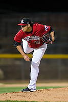 Hickory Crawdads starting pitcher Luis Ortiz (14) follows through on his delivery against the Kannapolis Intimidators at L.P. Frans Stadium on April 23, 2015 in Hickory, North Carolina.  The Crawdads defeated the Intimidators 3-2 in 10 innings.  (Brian Westerholt/Four Seam Images)