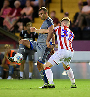 Lincoln City's Matt Rhead vies for possession with Stoke City's Nathan Collins<br /> <br /> Photographer Chris Vaughan/CameraSport<br /> <br /> Football Pre-Season Friendly - Lincoln City v Stoke City - Wednesday July 24th 2019 - Sincil Bank - Lincoln<br /> <br /> World Copyright © 2019 CameraSport. All rights reserved. 43 Linden Ave. Countesthorpe. Leicester. England. LE8 5PG - Tel: +44 (0) 116 277 4147 - admin@camerasport.com - www.camerasport.com