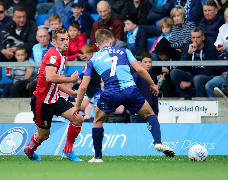 Lincoln City's Harry Toffolo vies for possession with Wycombe Wanderers' David Wheeler<br /> <br /> Photographer Andrew Vaughan/CameraSport<br /> <br /> The EFL Sky Bet League One - Wycombe Wanderers v Lincoln City - Saturday 7th September 2019 - Adams Park - Wycombe<br /> <br /> World Copyright © 2019 CameraSport. All rights reserved. 43 Linden Ave. Countesthorpe. Leicester. England. LE8 5PG - Tel: +44 (0) 116 277 4147 - admin@camerasport.com - www.camerasport.com