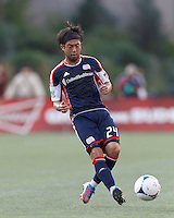 New England Revolution midfielder Lee Nguyen (24) passes the ball. In a Major League Soccer (MLS) match, New England Revolution defeated New York Red Bulls, 2-0, at Gillette Stadium on July 8, 2012.