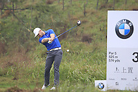 Oliver Fisher (ENG) tees off the 3rd tee during Thursday's Round 1 of the 2014 BMW Masters held at Lake Malaren, Shanghai, China 30th October 2014.<br /> Picture: Eoin Clarke www.golffile.ie
