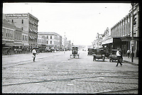 In this picture you can see Congress Avenue as it appeared in 1913, looking south as it appeared in 1913, cable car tracks line the cobblestone streets in downtown Austin, Texas.