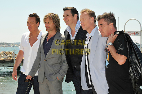 SPANDAU BALLET.Martin Kemp, Steve Norman, Tony Hadley, Gary Kemp and John Keeble.photocall .62nd International Cannes Film Festival.Cannes, France. 19th May 2009.half length black suit band group white shirt grey gray blue t-shirt profile .CAP/PL.©Phil Loftus/Capital Pictures