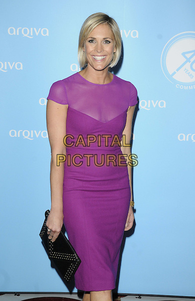 Jenni Falconer<br /> Arqiva Commercial Radio Awards at the Park Plaza, Westminster Bridge, London, England.<br /> July 3th 2013<br /> half length pink purple sheer dress black clutch bag<br /> CAP/CAN<br /> &copy;Can Nguyen/Capital Pictures
