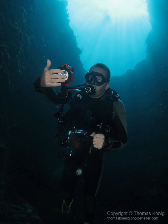 Blue Hole, Palau -- Diver inside the Blue Hole.