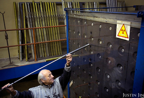 A scientist works at a model research reactor at the Moscow Civic Engineering Institute.