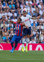 Toby Alderweireld of Tottenham Hotspur battles with Jordan Ayew of Crystal Palace during the Premier League match between Tottenham Hotspur and Crystal Palace at Wembley Stadium, London, England on 14 September 2019. Photo by Vince  Mignott / PRiME Media Images.