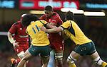 Wales number 8 Taulupe Faletau runs into trouble as Australia pair Joe Tomane and Sam Carter close in.<br /> Dove Men Series 2014<br /> Wales v Australia<br /> Millennium Stadium<br /> 08.11.14<br /> ©Steve Pope-SPORTINGWALES