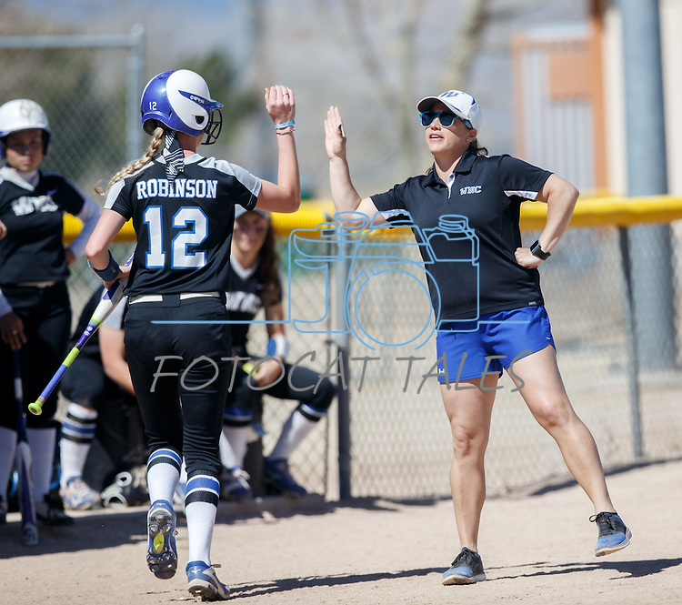Western Nevada's Coach Leah Henderson high fives Dakota Robinson after a hit against Colorado Northwestern at Edmonds Sports Complex Carson City, Nev., on Friday, March 18, 2016.<br /> Photo by Jeff Mulvihill, Jr./Nevada Photo Source
