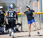 Western Nevada's Coach Leah Henderson high fives Dakota Robinson after a hit against Colorado Northwestern at Edmonds Sports Complex Carson City, Nev., on Friday, March 18, 2016.<br />
