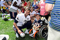 Wednesday, August 17, 2016: New England Patriots kicker Stephen Gostkowski (3) poses for a photo with a young fan at a joint training camp session between the Chicago Bears and the New England Patriots held at Gillette Stadium in Foxborough Massachusetts. Eric Canha/CSM