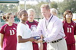 11 November 2007: Atlantic Coast Conference Assistant Commissioner for Championships Davis Whitfield (right) awards the Atlantic Coast Conference Tournament Most Valuable Player Award to North Carolina's Nikki Washington (left). The University of North Carolina defeated Florida State University 1-0 at the Disney Wide World of Sports complex in Orlando, FL in the Atlantic Coast Conference Women's Soccer tournament final.