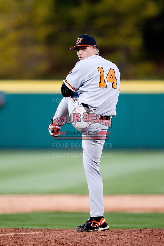 Phillip Wilson (14) of the Oklahoma State Cowboys winds up during a game against the Missouri State Bears at Hammons Field on March 6, 2012 in Springfield, Missouri. (David Welker / Four Seam Images)