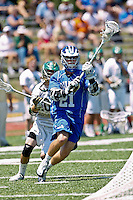 April 30, 2011:  Duke Blue Devils attack Zach Howell (21) during lacrosse action between the Duke Blue Devils and Jacksonville Dolphins at D. B. Milne Field in Jacksonville, Florida.  Duke defeated Jacksonville 10-6.