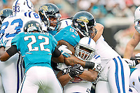 January 01, 2012: Indianapolis Colts running back Joseph Addai (29) (center) his tackled by Jacksonville Jaguars defensive tackle C.J. Mosley (99) and cornerback Kevin Rutland (22) during first half action between the Jacksonville Jaguars and the Indianapolis Colts played at EverBank Field in Jacksonville, Florida.  ........