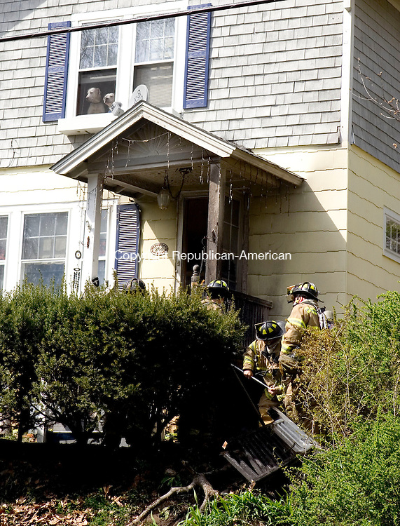 WATERBURY, CT- 25 APRIL 2008- 042508JT01-<br /> Two dogs bark from the second-floor window of 264 Park Dr. at the commotion in front of the Waterbury house as firefighters knock down a fire just outside the front door on Friday afternoon.<br /> Josalee Thrift / Republican-American