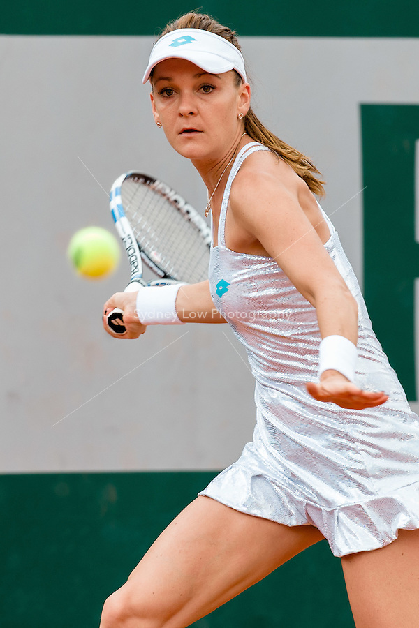 May 25, 2015: Agnieszka Radwanska (POL) in action in a 1st round match against  Annika Beck (GER) on day two of the 2015 French Open tennis tournament at Roland Garros in Paris, France. Sydney Low/AsteriskImages