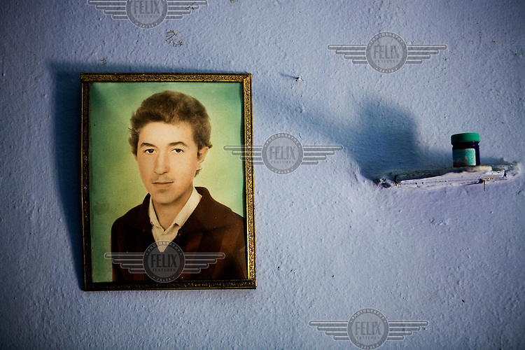 A picture of the brother of farmer Chirioghe Petrovicis, who has left Moldova to seek work opportunities in Western Europe, hangs on the wall of his home in Gagauzia an autonomous region of Moldova.