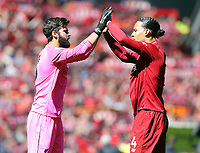 Liverpool's Alisson Becker (left) and Virgil van Dijk greet each other ahead of kick-off<br /> <br /> Photographer Rich Linley/CameraSport<br /> <br /> The Premier League - Liverpool v Wolverhampton Wanderers - Sunday 12th May 2019 - Anfield - Liverpool<br /> <br /> World Copyright © 2019 CameraSport. All rights reserved. 43 Linden Ave. Countesthorpe. Leicester. England. LE8 5PG - Tel: +44 (0) 116 277 4147 - admin@camerasport.com - www.camerasport.com