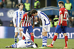 Real Sociedad's Capilla injured in presence of and Real Sociedad's Aritz Elustondo (l) and Ruben Pardo (c-r) and Atletico de Madrid's Augusto Fernandez (c-l) and Saul Niguez during La Liga match. March 1,2016. (ALTERPHOTOS/Acero)