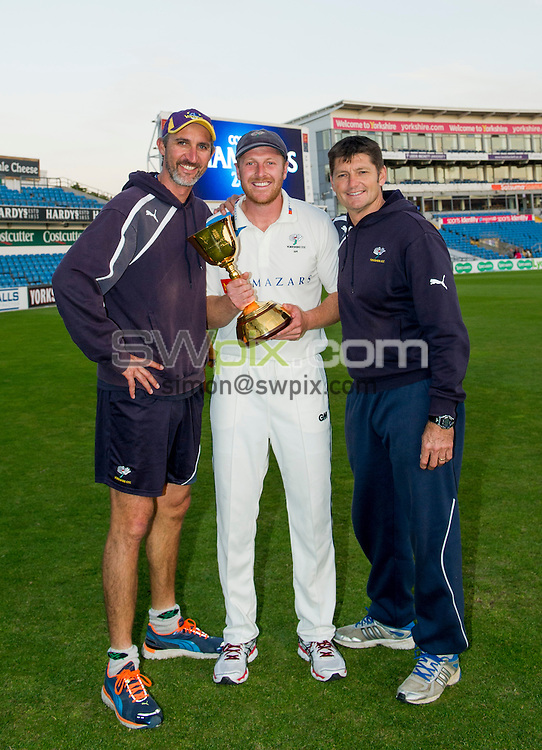 Picture by Allan McKenzie/SWpix.com - 26/09/2014 - Cricket - LV County Championship Div One - Yorkshire County Cricket Club v Somerset County Cricket Club - Headingley Cricket Ground, Leeds, England - Yorkshire's Jason Gillespie, Andrew Gale & Martyn Moxon with the County Championship Trophy.