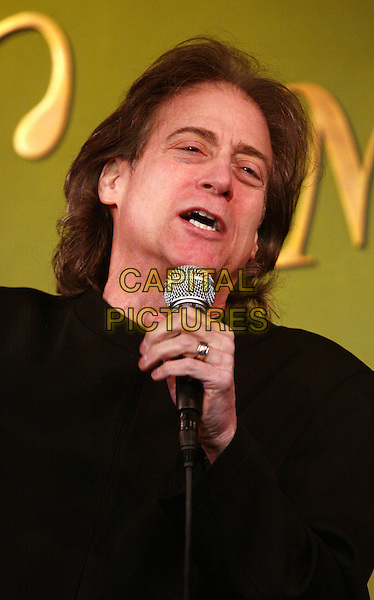 RICHARD LEWIS.Legendary comedian Richard Lewis does his stand up comedy act at COMIX NY, New York, NY, USA,.26th March 2010..portrait headshot black hand microphone mouth speaking on stage performing show.CAP/ADM/PZ.©Paul Zimmerman/AdMedia/Capital Pictures.