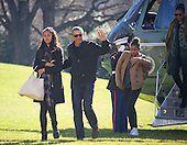 United States President Barack Obama waves to the assembled press as he and his family return to the South Lawn of the White House in Washington, DC following their two week Hawaiian vacation on Sunday, January 3, 2016. From left to right: Malia Obama, The President, Sasha Obama, and first lady Michelle Obama.<br /> Credit: Ron Sachs / Pool via CNP