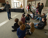 NWA Democrat-Gazette/ANDY SHUPE<br /> Curator Khalid el-Hakim (from left) of Detroit explains the history behind artifacts on display Friday, Feb. 9, 2018, for students from Ramay Junior High School in Fayetteville as they visit the Black History 101 Mobile Museum inside the Janelle Y. Hembree Alumni House on the University of Arkansas campus in Fayetteville. A selection of 200 items from a collection of more than 7,000 artifacts from black history in the U.S. was hosted by the Sam M. Walton College of Business Office of Diversity and Inclusion and The Visionairi Foundation.