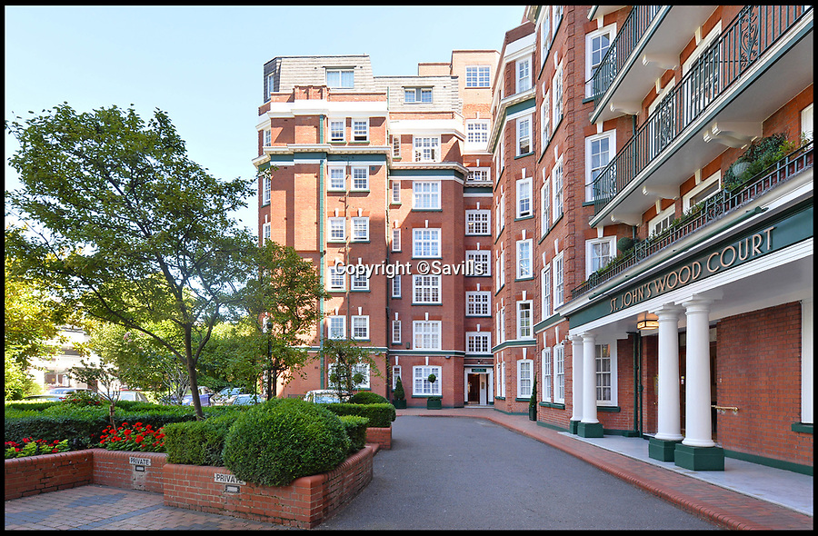 BNPS.co.uk (01202) 558833<br /> Pic :   Savills/BNPS<br /> <br /> Howzat!<br /> <br /> An impressive London penthouse with excellent views over Lord's - on the market for £4.5m - is the ideal home for a cricket fan.<br /> <br /> Sport lovers could watch this summer's Cricket World Cup final from the balcony of the stylish apartment on the seventh floor of St John's Wood Court.<br /> <br /> Both the stands and some of the green are visible, just 330 yards away, above the treetops and roofs of neighbouring properties.<br /> <br /> The three-bedroom penthouse, on the market with Savills, also has a swanky built-in bar in the living/dining room, making it the perfect place to entertain.
