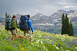 A young couple surveys the view while hiking in the Targhee National Forest, Wyoming.
