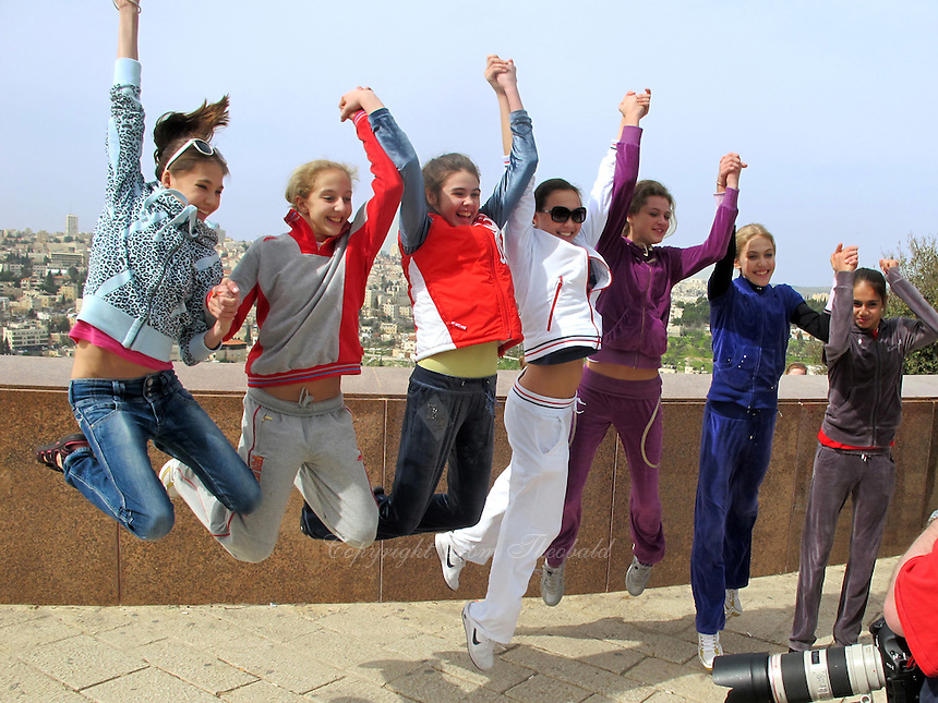 Another fun moment (L-R) mostly RUS team: Ralina Rakipova, Diana Borisova, Alexandra Merkulova, Anna Alyabyeva, Nataliya Bulycheva, Elizaveta Nazarenkova, Rita Mamun leap for cameras during daytrip to Jerusalem. From 2011 Holon Grand Prix, Israel on March 6, 2011. (Photo by Tom Theobald)