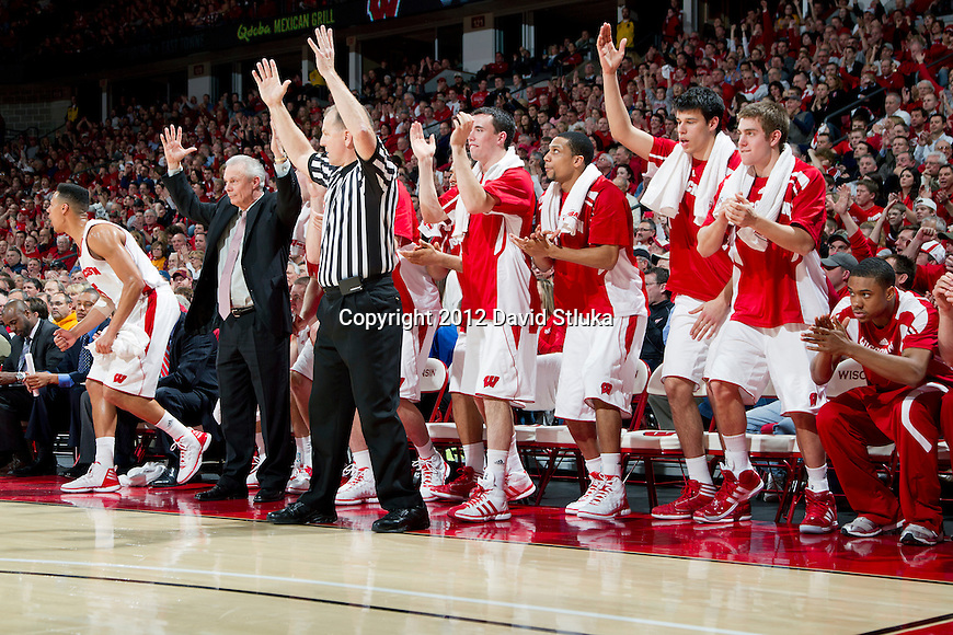 Wisconsin Badgers celebrate a Ben Brust (1) 3-pointer during a Big Ten Conference NCAA college basketball game against the Minnesota Golden Gophers on Tuesday, February 28, 2012 in Madison, Wisconsin. The Badgers won 52-45. (Photo by David Stluka)