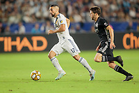 CARSON, CA - SEPTEMBER 15: Sebastian Lletget #17 of the Los Angeles Galaxy looks for an open man during a game between Sporting Kansas City and Los Angeles Galaxy at Dignity Health Sports Complex on September 15, 2019 in Carson, California.