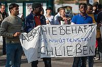 """Fluechtlingsdemonstration in Frankfurt an der Oder.<br /> Im Rahmen eines Protestcamps gegen das Fluechtlings-Aufnahmelager im knapp 30 Km entfernten Eisenhuettenstadt. Die ca 100 Demonstranten forderten u.a. die Abschaffung der Lager als Unterkunft fuer Asylsuchende, die Abschaffung der Residenzpflicht - """"Freedom of Movement"""". Flucht sein kein Verbrechen, so die Fluechtlinge.<br /> Vor Beginn der Demonstration gab es einige rassistische Poebeleien von Passanten.<br /> 26.8.2014, Frankfurt an der Oder<br /> Copyright: Christian-Ditsch.de<br /> [Inhaltsveraendernde Manipulation des Fotos nur nach ausdruecklicher Genehmigung des Fotografen. Vereinbarungen ueber Abtretung von Persoenlichkeitsrechten/Model Release der abgebildeten Person/Personen liegen nicht vor. NO MODEL RELEASE! Don't publish without copyright Christian-Ditsch.de, Veroeffentlichung nur mit Fotografennennung, sowie gegen Honorar, MwSt. und Beleg. Konto: I N G - D i B a, IBAN DE58500105175400192269, BIC INGDDEFFXXX, Kontakt: post@christian-ditsch.de<br /> Urhebervermerk wird gemaess Paragraph 13 UHG verlangt.]"""