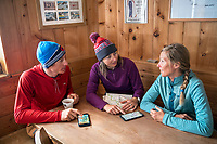 Discussing plans for the Öztal ski tour, Austria, while in the Bella Vista Hut. The weather turned bad and options had to be considered.