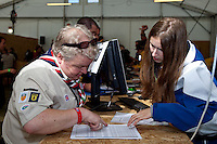 A leader from the UK contingent checking in their participants. Photo: Kim Rask/Scouterna