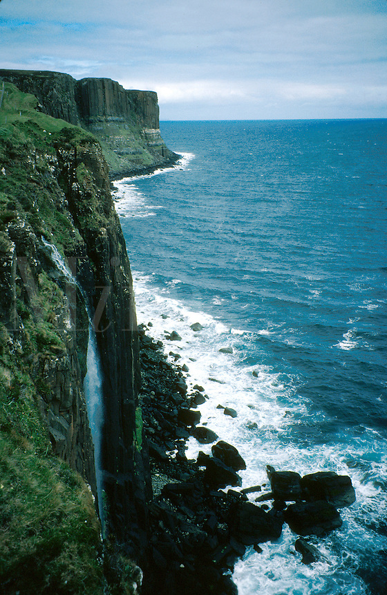 Basalt rock formations and waterfalls on the coastline of the Scottish Isle of Skye. Rugged, rocky coast, coastal landscape, cliffs. Scotland Great Britain Isle of Skye.