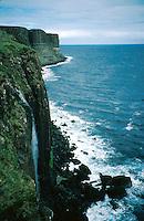 Basalt rock formations and waterfalls on the coastline of the Scottish Isle of Skye. Rugged, rocky coast, coastal landscape, cliffs. Scotland Great Britain Isle of Skye.