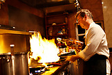 BELIZE, Hopkins, Chef Rob prepares an entree at his restaurant, Chef Rob's Gourmet Cafe
