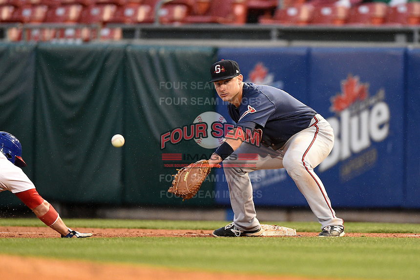 Gwinnett Braves first baseman Joey Terdoslavich (7) takes a pickoff attempt throw during a game against the Buffalo Bisons on May 13, 2014 at Coca-Cola Field in Buffalo, New  York.  Gwinnett defeated Buffalo 3-2.  (Mike Janes/Four Seam Images)