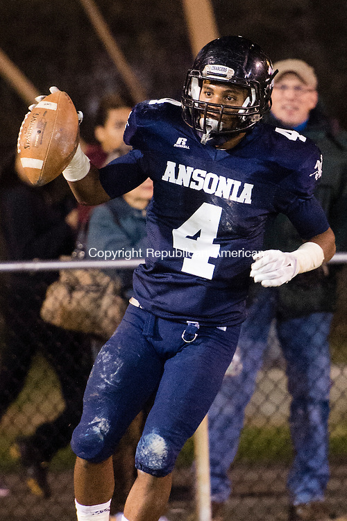 ANSONIA, CT - 7 December 2015-120715EC01-- Action man. Ansonia's Tajik Bagley holds up the ball after his touchdown against Trinity Catholic Monday night. Erin Covey Republican-American.