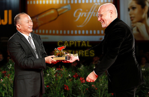 JOHN WOO, MARCO MULLER.Wins the Golden Lion award for Lifetime Achievement during the .67th Venice International Film Festival in.Venice, Italy, September 3rd, 2010.half length prize black suit tie smiling director white shirt side .CAP/PE.©Peter Eden/Capital Pictures.