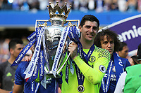Chelsea's Thibaut Courtois holds the Premier League Trophy as he celebrates winning the Premier League during Chelsea vs Sunderland AFC, Premier League Football at Stamford Bridge on 21st May 2017