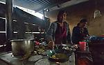 Atalia Cinto (left) and Arcadia Ventura cook breakfast for their family in San Jose la Frontera, a small Mam-speaking Maya village in Comitancillo, Guatemala.