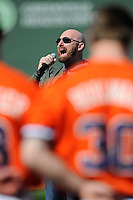 Singer Corey Smith sang the National Anthem before the Reedy River Rivalry game on March 1, 2014, at Fluor Field at the West End in Greenville, South Carolina. South Carolina won, 10-2. (Tom Priddy/Four Seam Images)