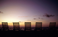 Row of beach chairs overlooking the ocean.