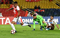 BOGOTA - COLOMBIA - 20 – 02 - 2018: Wilson Morelo (Izq.), jugador de Independiente Santa Fe, anota gol a Mauricio Viana (Der.), portero de Santiago Wanderers, durante partido de vuelta entre Independiente Santa Fe (COL) y Santiago Wanderers (CHL), de la fase 3 llave 1, por la Copa Conmebol Libertadores 2018, jugado en el estadio Nemesio Camcho El Campin de la ciudad de Bogota. / Wilson Morelo (L) player of Independiente Santa Fe, scored a goal to Mauricio Viana (R), goalkeeper of Santiago Wanderers, during a match for the second leg between Independiente Santa Fe (COL) and Santiago Wanderers (CHL), of the 3rd phase key 1, for the Copa Conmebol Libertadores 2018 at the Nemesio Camacho El Campin Stadium in Bogota city. Photo: VizzorImage  / Luis Ramirez / Staff.