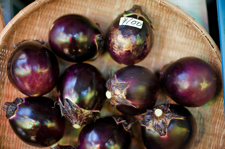 Tiny purple round Japanese aubergines or eggplants for sale at the Nishiki Market in Kyoto.