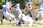 Palos Verdes, CA 09/13/13 - Ryan Augello (Peninsula #29), Carlo Merola (Peninsula #60), Nico Melendez (Culver City #88), Remy Grundy (Culver City #15) in action during the Culver City vs Palos Verdes Peninsula High School Varsity Football game at Palos Verdes Peninsula HIgh School.